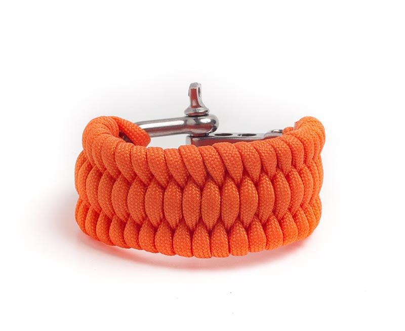Paracord överlevnadsarmband i orange färg.
